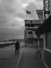 Mission Beach Lifeguard Station (greenschist) Tags: zenzanonrf65mmf california usa film flag 6x45 pacificocean mediumformat rolleiretro400s people blackwhite bronicarf645 missionbeach lifeguardstation analog clouds