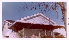 Cloyd in Front of the House, Xmas 1961 (Alan Mays) Tags: ephemera photos photographs foundphotos colorphotos snapshots portraits men heads buildings houses homes houseproud flaws flawed humor humorous funny amusing christmas xmas december25 holidays 1961 1960s antique old vintage jackrabbit jackrabbitco spartanburg sc southcarolina companies filmdevelopers filmprocessors