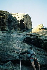 Going Up (Brogan's Camera) Tags: shade climbing outdoors suspense rock cliff nature wilderness 35mm pentax analog film kodak ultramax