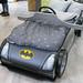 Kinderbett in Form eines Batmobils mit Batman-Zeichen und Lenkrad in Möbelhaus