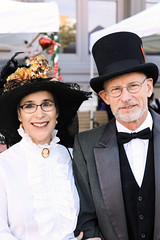 Couple In Hats (wyojones) Tags: texas galveston dickensonthestrand holidayfestival hat skirt brunette hair girl lady lovely woman beautiful beauty lace smile pretty blouse man gentleman tophat suit beard bowtie handcerchief cane glasses