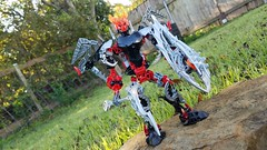Bionicle M.O.C. - Firon (fire-iron) Angel (Makuta Alvarez) Tags: red bionicle lego toy angel black shield sword spear wings moc warrior protector fire skull spider armor