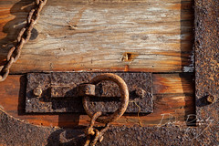 Beautiful Rust (Dave Denby) Tags: rust rusty metal steel chain corroded weathered door wood boat vessel