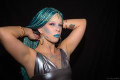 Out Of The Corner (Fly Sandman) Tags: model modelshoot crystaldivoky blue blueeyes bluehair blackbackground woman mermaid omaha nebraska tattoo