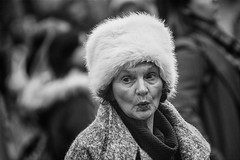 Oh my! (Frank Fullard) Tags: frankfullard fullard candid street portrait puckered surprise wonder emotion face expression lady fur hat black white blanc noir dublin irish ireland
