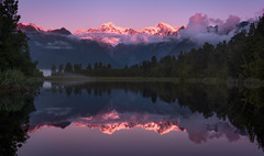 Glowing Peaks (inkasinclair) Tags: lake matheson new zealand mount cook sunset reflection mt tasman west coast