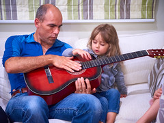 Nieces on the Couch 5 (ArdieBeaPhotography) Tags: couch sofa sit preschooler inside lounge livingroom carpet drapes curtains blinds cute girl long blonde hair man uncle play guitar pluck strum strings music help together fun create tune bald bare feet tamronspaf2875mmf28xrdildasphericalif