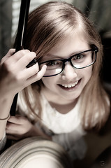 Girl in Glasses [Explored 2019-03-27 # 392] (Kevin MG) Tags: gl1 girl young youth cute pretty little adolescent adorable portfolio portrait session elementary schoolage glasses desaturated indoor smile teeth