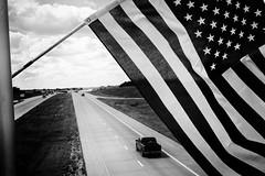 XPR24616-Edit (alhawley) Tags: american americanabstract americanflag bw usa blackandwhite flag fujifilmxpro2 fujinonxf35mmf2rwr grain gritty monochrome nationalflag street streetphotography