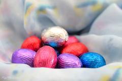 Colours and tastes... (Maria Godfrida) Tags: lookingcloseonfriday eggs objects closeup macro colours tastes easter highkey heap shiny bokeh light chocolate