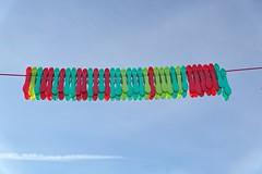 clothespins - Wäscheklammern (Veit Schagow) Tags: niedersedlitz dresden detail clothespins wäscheklammern himmel blue diverse colors green red wäscheleine sky rot blau gruen