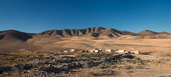 La Florida (toniertl) Tags: barren laflorida abandoned arid canaryisland deserted emptyvillage fuerteventura ghosttown hills mountains toniphotoxoncouk wintersunshine dry dusty derelict crumble broken orange blue scrubby