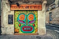 Le masque (Isa-belle33) Tags: architecture urban urbain city ville wall mur shop storefront magasin boutique colors couleurs fujifilm bordeaux street streetphotography streetart streetartbordeaux
