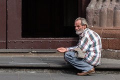 Brother, can you spare a dime? (Gene Mordaunt) Tags: poor beggar doorway alms begging handout nikon810