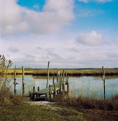 Brookhaven NY (djrocks66) Tags: landscapes waterscapes nature outdoors marina water river bay ny long island medium format film filmisnotdead fpp flexaret tlr 120 roll dock boats clouds ishootfilm kodak portra fishing