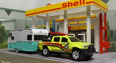 Heading For The Beach. (ManOfYorkshire) Tags: matchbox diecast toys cars caravan shasta airflyte greenlight scale models shell garage diorama fuel towing official vehicle detailed toyota tacoma pickup truck equipment 164 surfboards beach rescue