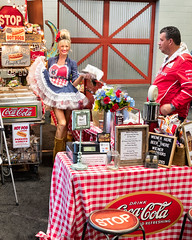 Not Your Average Hot Dog Vendor (Ron Drew) Tags: fun nikon d850 vendor hotdog scottsdale arizona barrettjackson carshow westworld streetphotography indoors ambientlight food dress boots