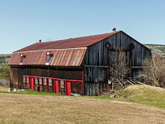 Day 12, SW of Port-au-Persil, Quebec (annkelliott) Tags: quebec canada betweentadoussacandquebeccity building architecture barn old weathered roof rusty wood windows scenery rural ruralscene hills grass tree sky outdoor spring 18may2018 fz200 fz2004 panasonic lumix annkelliott anneelliott ©anneelliott2018 ©allrightsreserved