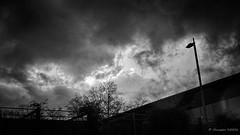 Une lumière, et l'espoir (Alexandre DAGAN) Tags: oloronsaintemarie pyrénéesatlantiques nouvelleaquitaine france ciel cielo sky nuages clouds nuves noir blanc black white noiretblanc noirblanc blacknwhite blackandwhite blanckandwhite orage storm rain pluie panasoniclx100 panasonic lx100 dmclx100 voyage travel roadtrip temps weather groupenuagesetciel