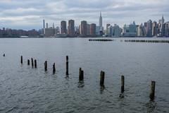 Pointy in Greenpoint (BrianEden) Tags: brooklyn empirestatebuilding manhattan pier newyorkcity newyork pole nyc pylons eastriver greenpoint unitedstatesofamerica us