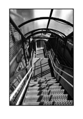 Don't look back (blueP739) Tags: olympus om4 om1n olympusom om3ti om2sp om10 om1 om2n om3 olympusom1 orange olympusplustekplustek7200om4 pussy plustek7200 vivitar19mm street stairs streetphotography london londonskyline londonoverground metalstairs train