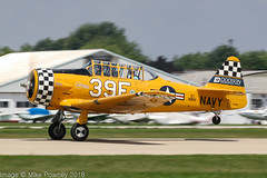 N3639F - 1945 build North American SNJ-6 Texan, rolling for departure on Runway 27 at Oshkosh during Airventure 2018 (egcc) Tags: 39f 12142981 148112 airventure airventure2018 breakevenaircraftresourcing dodsoninternationalparts eaa harvard kosh lightroom n3639f navy northamerican osh oshkosh republicairline snj6 texan usnavy