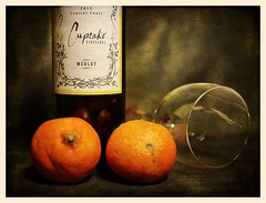 Still Life (N.the.Kudzu) Tags: tabletop stilllife wine bottle glass tangerines canoneosm 7artisans25mmf18 photoscape texture
