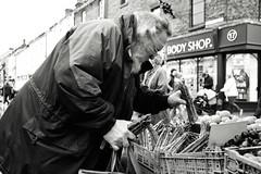 Choosing the Best (Bury Gardener) Tags: monochrome mono burystedmunds bw blackandwhite britain 2018 nikon nikond7200 england eastanglia uk people peoplewatching folks suffolk streetphotography street streetcandids snaps strangers cornhill