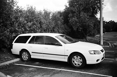 2007 Ford Falcon station wagon (Matthew Paul Argall) Tags: kodakstar500af 35mmfilm blackandwhitefilm blackandwhite ilforddelta100 100isofilm ford fordfalcon stationwagon car vehicle automobile transportation