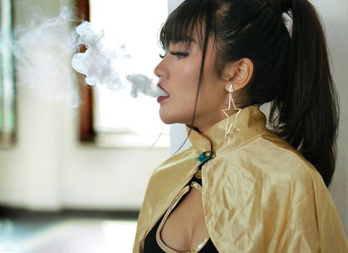 Busty deelite smoking photographs