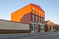 Alkire Building — Mount Sterling, Ohio (Pythaglio) Tags: building structure mountsterling ohio unitedstatesofamerica us historic altered threestory fivebay italianate brick storefronts madisoncounty sidewalk street 11windows mad914 alkire