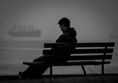 Lonely (Jarrod McKenna) Tags: male cloudy ship ocean bench lonely blackandwhite englishbay foggy misty