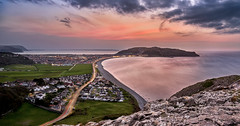 Sunset over Llandundo in North Wales (Marcin Frączek) Tags: sky bodyofwater sea coast water shore sunset ocean beach cloud gb waterresources horizon bay rock landscape redclouds evening reflection mountain sunrise lighttrail northwales dusk llandudno wales uk nature light