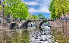 Canal Bridge. Amsterdam, Holland (mtm2935) Tags: clouds sky trees boats bicicletas landscape panorama bridge water canals cruise
