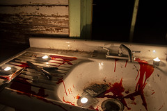 Kitchen of a long Abandoned House filled with lit Candles, Knives, and Blood on a Dark Night (JacobBoomsma) Tags: halloween melted room satan curse ritual burning horror sinister thewitch witchcraft call scorched dimlighting spy secret satanic ancient flame flamed darkness fear candles devil holiday spell dark blackmagic furnished mysterious themagician antique wax table house magic light scary abandoned paper