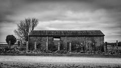 precast concrete garage (old barn) (Redheadwondering) Tags: sonyα7ii landscape salisburyplain wiltshire sigma sigma2470lens byway blackwhite bw barn fence 76themundanemadeinteresting 76 mundane interesting tree clouds 119picturesin2019