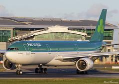 Aer Lingus A330-300 EI-GAJ (birrlad) Tags: dublin dub international airport ireland aircraft aviation airplane airplanes airline airliner airways airlines taxi takeoff taxiway departing departure runway sunlight sunset evening airbus a330 a333 a330300 a330302 eigaj shamrock