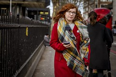 Something Red (Leanne Boulton) Tags: urban street candid portrait portraiture streetphotography candidstreetphotography candidportrait streetportrait streetlife woman female girl face eyes expression mood feeling bright red coat scarf redhead colourful euston fence railings tone texture detail depthoffield bokeh naturallight outdoor light shade city scene human life living humanity society culture lifestyle people fashion style canon canon5dmkiii color colour london england uk