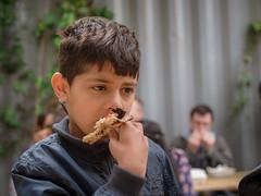 Little Boy Eating Pizza (Hattifnattar) Tags: little boy eating pizza pentax bokeh street fa43mm limited london portrait naturallight