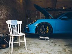 Porsche 911 GT3 being worked on at String Theory Garage. (Smashatom) Tags: stringtheory theory string garage engine chair wheel calliper callipers thirds four micro mu43 mirrorless 15mm leica lumix panasonic microfourthirds omd em5 olympus warwickshire avon upon stratford stratforduponavon cultofmachine cult caffeineandmachine machine caffeine electric electricblue blue sports car super supercar gt3 911 porsche