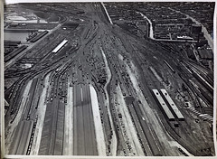 Aerial view of Spencer Street Yards looking towards North Melbourne (Public Record Office Victoria) Tags: railways train electrification blackandwhite archives victoria aerial melbourne spencer street yards trains traffic sheds 1919