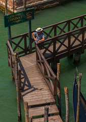 High angle view of a gondolier on a wooden pontoon, Veneto Region, Venice, Italy (Eric Lafforgue) Tags: adult architecture buildingexterior canal colourimage cultures day europe famousplace gondolier hat highangleview history internationallandmark italianculture italy journey mediterraneanculture men onemanonly oneperson outdoors photography pole pontoon romance scenics tourism travel traveldestinations unescoworldheritagesite vacations venetianlagoon veneto venezia venice veniceitaly venice290 vertical water venetoregion