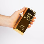 Hand holding a gold bar thumbnail