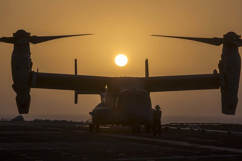 A Marine Corps MV-22B Osprey is prepared for takeoff while aboard the Wasp-class amphibious assault ship USS Essex (LHD 2)