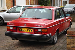 1989 Volvo 240GL, 2 (doojohn701) Tags: red vintage retro classic car driveway wall 1980s reflection houses 1989 volvo 240gl sweden france uk vegetation white silver