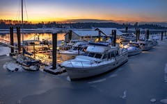 Candlelight on ice (Christie : Colour & Light Collection) Tags: boats marina harbour harbourauthority night candlelight haney bc mapleridge canada britishcolumbia frozen ice frozenriver riverbank nikkor winter outdoors nightphotography cold icy lighting mood romantic