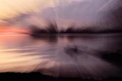 Sunrise canoeists (mrsparr) Tags: activeassignmentweekly canoeists lakeontario humberbayshoresneighborhood toronto ontario canada sunrise zoomburst 119in2019 2