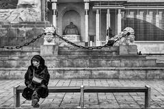 Seated Lady With Fur Coat  (Ulaanbaatar, Mongolia. Gustavo Thomas © 2019) (Gustavo Thomas) Tags: seated lady square ulaanbaatar ulánbatór mongolia mongolian people asia snowfall cold winter furcoat blackandwhite mono monochrome monocromático bnw travel gente streetphotography life nieve invierno voyager voyage