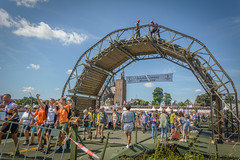 Triumphal arch (stevefge) Tags: cuijk vierdaagse2017 vierdaagse arch limburg churches march marchers orange banner rivers maas summer tower spire people candid street crowds crossing bridges event unsuspectingprotagonists reflectyourworld