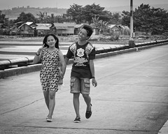 Happy Couple (Beegee49) Tags: street filipina young couple walking holding hands happy planet seafront esplanade panasonic fz1000 cadiz city philippines asia black white monochrome bw happyplanet asiafavorites